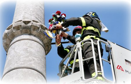 The Firemen and the historical seal of Udine